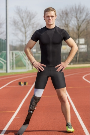 race track: Athlete with handicap stands on a race track