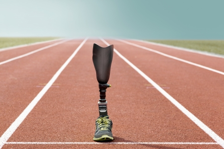 prosthesis: Athletic sports prosthesis of a disabled athlete stands on a tartan track