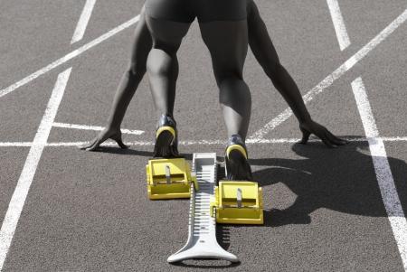 start position: Dark-skinned sprinter in start position prepares for the start Stock Photo