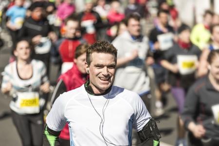 Sportive man in his forties runs a marathon