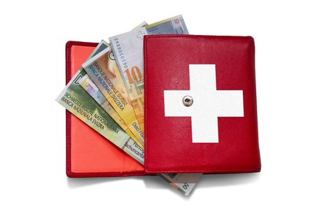 swiss franc: Red wallet with swiss franc banknotes Stock Photo