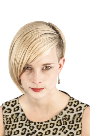 Young woman with leopard costume and piercing look photo