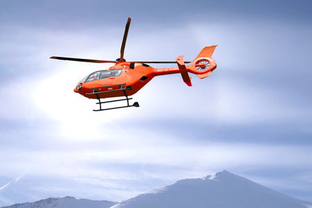 vats: Red helicopter flies over snow capped mountain summits