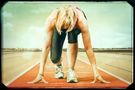 Female runner starting on runway Added vintage effect photo