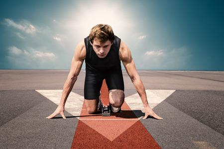 Male athlete on airport runway preparing for his start Banque d'images