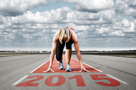 Female sprinter waiting for the start on an airport runway In the foreground perspective view of the  date 2015  photo