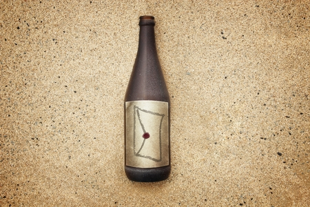 washed out: Vintage version of washed out bottle on a gravel beach, with envelope and seal on  label
