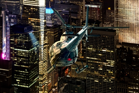 Helicopter night flight between the skyscrapers of New York Manhattan district