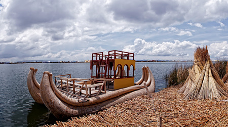 anchoring: Titicaca lake reed boat anchoring at the traditional reed islands of the Uru people