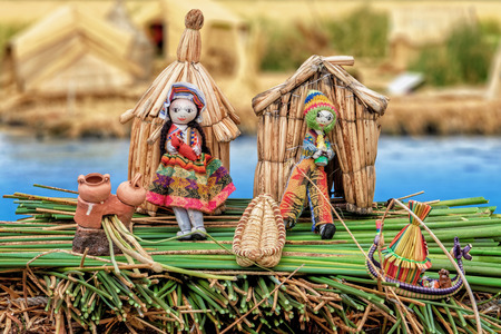 native american woman: From the Uru People of the Titicaca lake created composition to document the life of the Urus. In the background blurred original Uru huts on a reed Iceland. Stock Photo