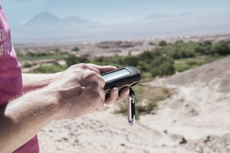 caching: Geocaching in the desert of Atacama , Chile, seeks for a cache. Stock Photo