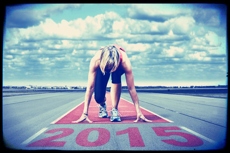 Female sprinter waiting for the start on an airport runway.In the foreground perspective view of the date 2015. This version interpreted as old screen frame. Banque d'images