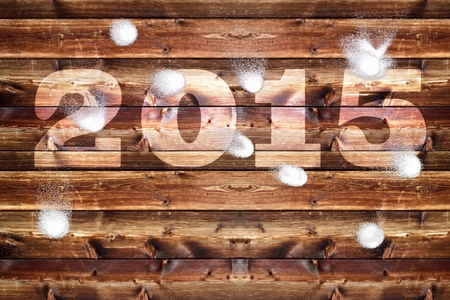 bombardment: Wooden board with bleached out 2,015 letters, Which is bombarded with snowballs. Stock Photo