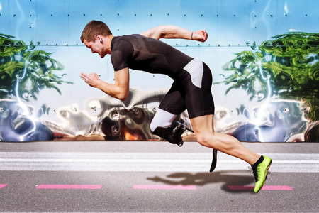 Explosive sprint of male athlete on road surface with strong reflecting metal background. Filtered version.