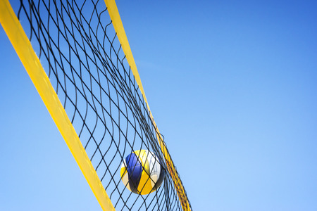 nets: Beach volleyball caught in the net. Stock Photo