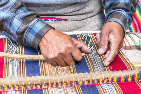 creates: Peruan weaver creates a carpet