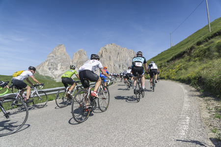 cycler: DOLOMITE ALPS, ITALY-JULY 05, 2015:  Some of the ten thousend  participants of the Maratona dles Dolomites bicycle twenty-four-seven hours road race in the mountains of the italian Dolomites at the first hours of the race. Editorial