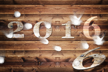 snowballs: Wooden board with year 2016  letters, which is plastered with snowballs. Stock Photo