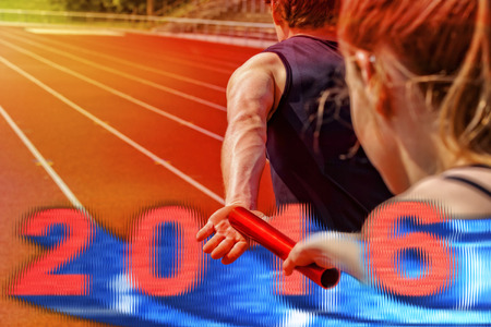 handing over: Relay race athletes handing over the pole. Overlay of 2016 motion blurred date with 3d effect. Stock Photo