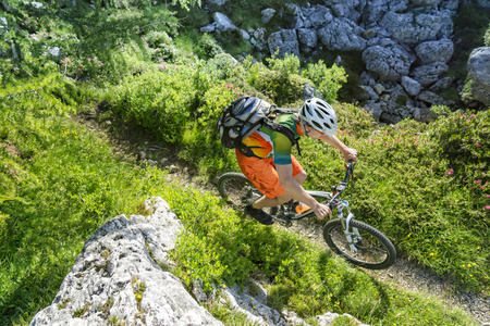mountainbike: Top view shot of a mountain biker riding a single trail in the mountains