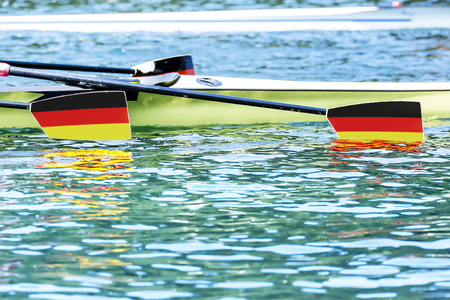 paddles: Three paddles with german coat of arms label dive into the water Stock Photo