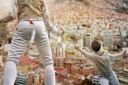 fencers: Two fencers fighting above the roofs of the city