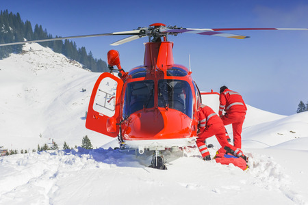 Rescue helicopter team prepares for emergency response Stock Photo