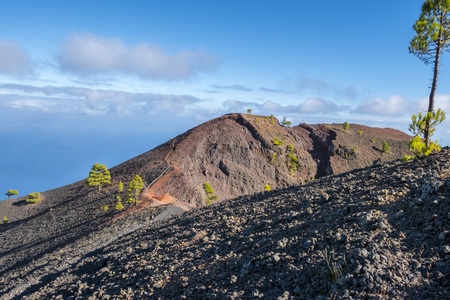 ruta: Shot of the famous hiking path Ruta de los vulcanos , taken in the south of la Palma nearby Los Canarios. View at the rim of a volcano crater