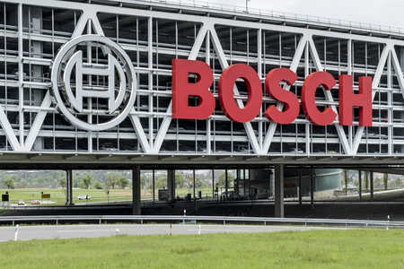 overbridge: STUTTGART, GERMANY - APRIL 22, 2017: Huge Bosch letters at the Stuttgart Airport Parking Garage. Bosch is a German multinational engineering and electronics company.