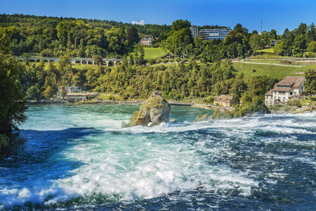 View of the huge waterfall Rhine fall in switzerland, which is one of the largest waterfalls in europe Stock Photo