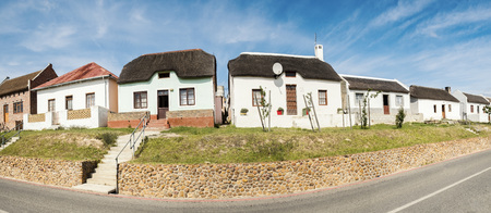 Panorama photo of characteristic cape dutch architecture near Elim South Africa, freeway 43.