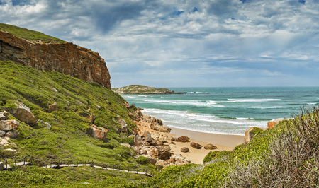 Tremendous Robbberg nature reserve coastline at Plettenberg bay South Africa. The photo shows a part of the wooden loop trail of the area