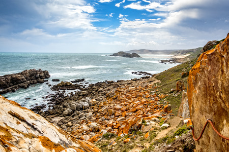 Tremendous Robbberg nature reserve coastline at Plettenberg bay South Africa. The photo shows a part of the loop trail with guide rope.