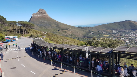 CAPE TOWN, SOUTH AFRICA - NOVEMBER 17, 2017: Tourists standing in line at the entrance to the Table Mountain cable car, wating for admission.