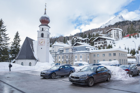 DAVOS, SWITZERLAND-JANUARY 26, 2018: World Economic Forum Annual Meeting. The photo shows the parking spot with limousines and the Steigenberger grandhotel