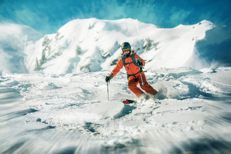 Female skiers action skiing in deep snow