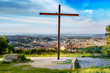 Rubble hill Birkenkopf in Stuttgart, Germany, with its huge rusty cross on the top Stock Photo