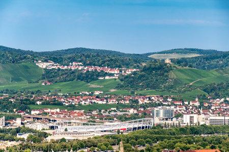 STUTTGART, GERMANY - JULI 10, 2018: View over Stuttgart from Killesberg tower with the Mercedes Benz stadium in the center