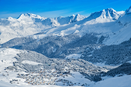 Beautiful snow capped mountains surrounding Arosa village.