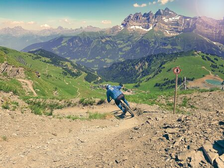 Mountain bike downhill rider on downhill trail Фото со стока