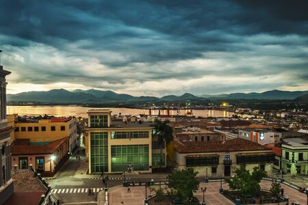 Santiago de Cuba at dusk. View from above with the port in the background.