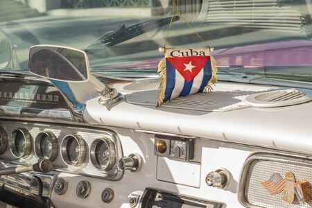 Havana, Cuba- 11 02 2019: Interior shot of historic car with cuba banner on the windshield.