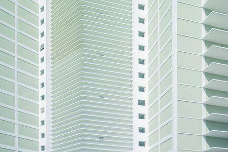 Uniform greenish facade of new building