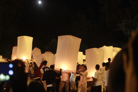 A group of people prepare to release their lantern to the sky for Vesak night celebration at Borobudur Temple, Indonesia