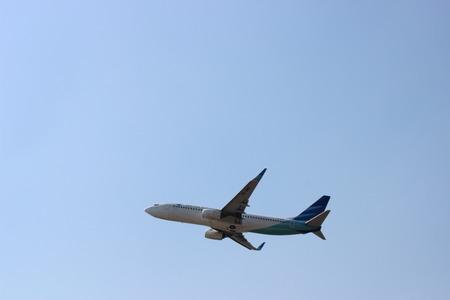 Garuda Indonesia Boeing 737-8U3NG (PK-GMZ) taking off from Adi Sumarmo International Airport, Solo, Indonesia