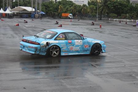 A Blue Nissan Silvia S14 drifting at Achilles Motorsport Festival 2015, Jakarta, Indonesia