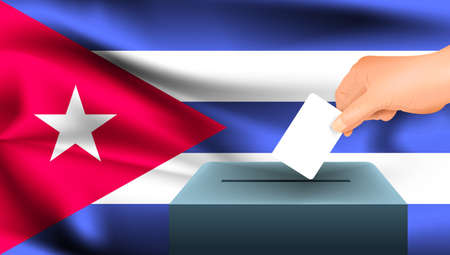 Male hand puts down a white sheet of paper with a mark as a symbol of a ballot paper against the background of the Cuba flag. Cuba the symbol of elections