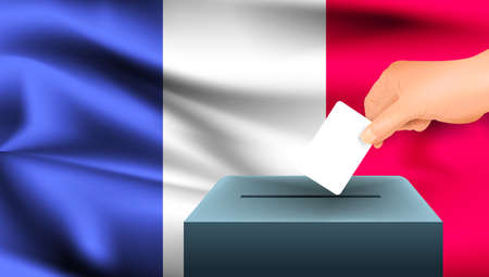 Male hand puts down a white sheet of paper with a mark as a symbol of a ballot paper against the background of the France flag. France the symbol of elections