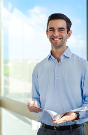 sucessful: Sucessful young business men holding documents. Stock Photo