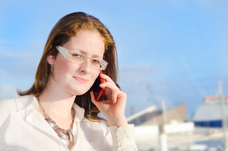 businees: Sucessfull young woman making a phone call.